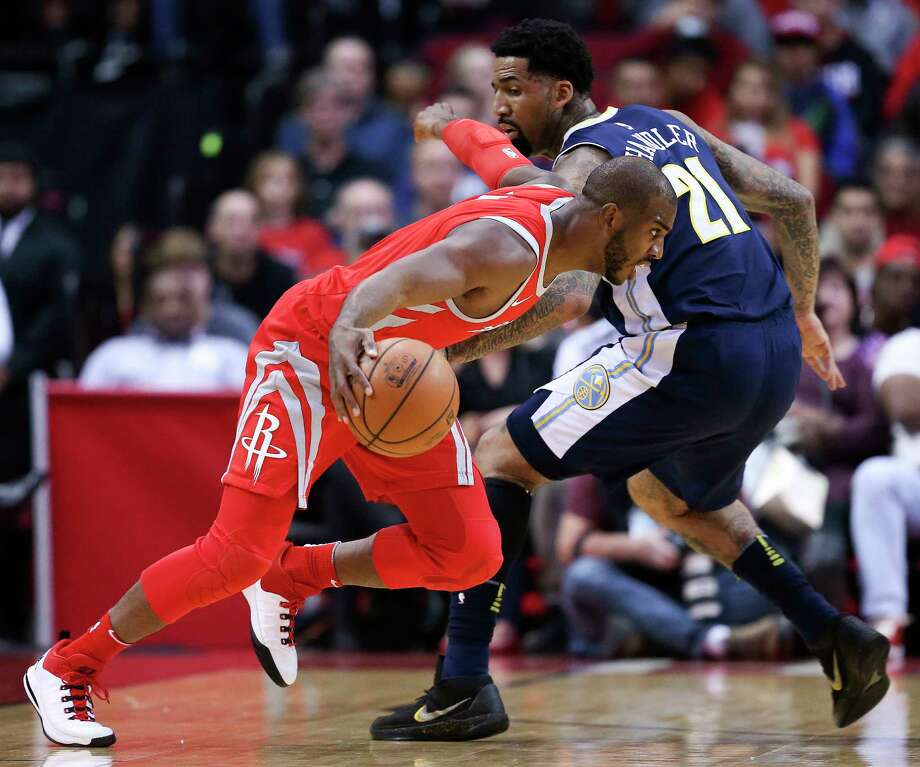 The Rockets' Chris Paul leaves the Nuggets' Wilson Chandler behind on his way to 23 points and 12 assists Wednesday night. Photo: Eric Christian Smith, FRE / FR171023 AP