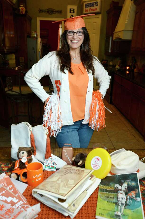 Carol Barranco-Sanders keeps an assortment of memorabilia from her days as a student at French High School, including her letter sweater, drill team boots and football programs. A group of French alumni are planning a holiday season reunion to raise money for the Empty Stocking Fund.  Photo taken Wednesday 11/22/17 Ryan Pelham/The Enterprise Photo: Ryan Pelham / ©2017 The Beaumont Enterprise/Ryan Pelham