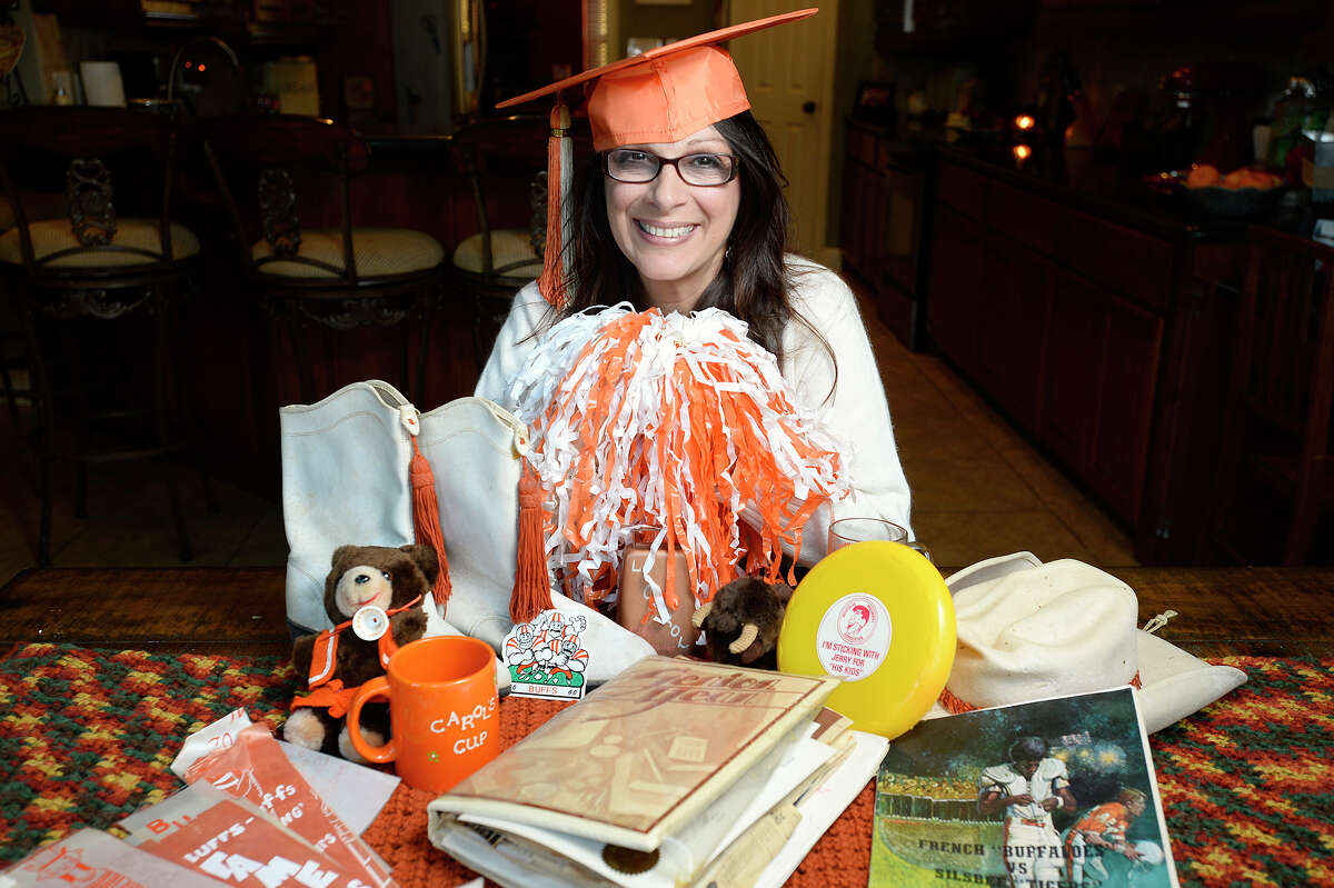 Carol Barranco-Sanders keeps an assortment of memorabilia from her days as a student at French High School, including her letter sweater, drill team boots and football programs. A group of French alumni are planning a holiday season reunion to raise money for the Empty Stocking Fund. Photo taken Wednesday 11/22/17 Ryan Pelham/The Enterprise
