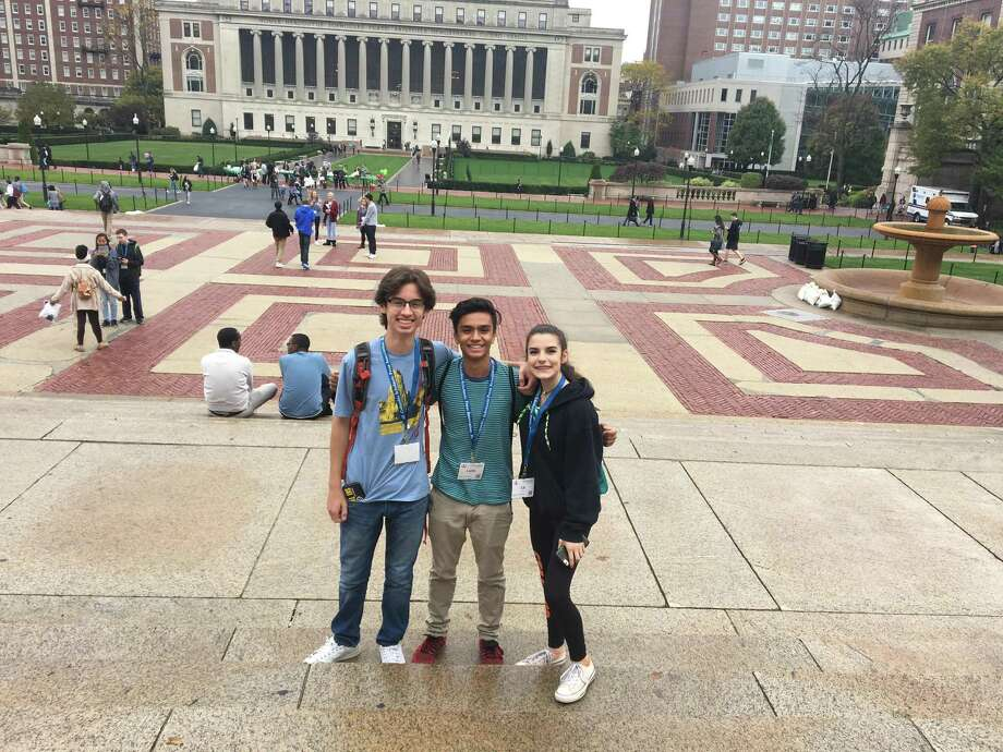 From left, Stamford High juniors Nathan Dancy, Lalith Goli and Elizabeth Santoro attend the 78th annual Columbia Scholastic Press Association Fall Conference. Photo: Sophia Scorziello / Contributed Photo