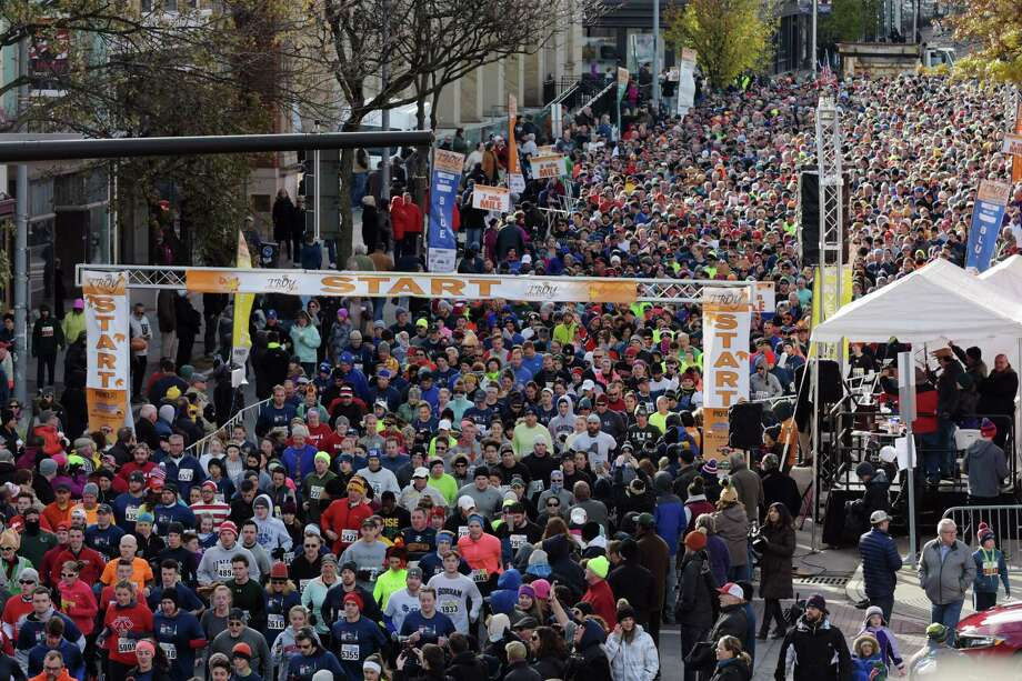 Runners make their way onto the course after the start of the 5K race at the 70th annual Troy Turkey Trot on Thursday, Nov. 23, 2017, in Troy, N.Y.   (Paul Buckowski / Times Union) Photo: PAUL BUCKOWSKI / 20042187A