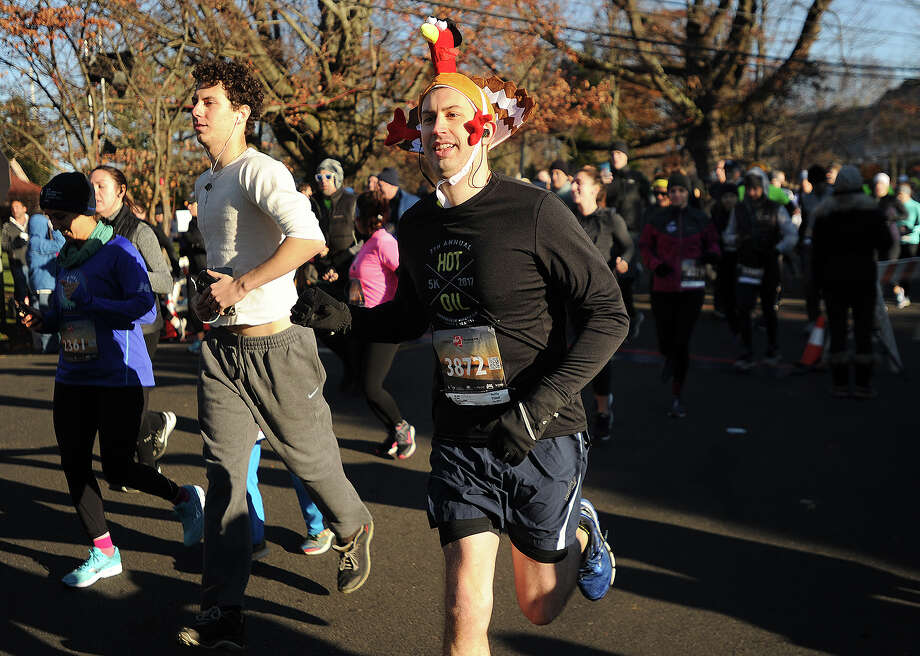 Chris Mackeprang, of Fairfield, is one of many runners to don festive holiday headgear for the annual Pequot Runners 5-mile Thanksgiving Day Road Race in the Southport section of Fairfield, Conn. on Thursday, November 23, 2017. Over 4000 runners registered for this year's race. Photo: Brian A. Pounds, Hearst Connecticut Media / Connecticut Post