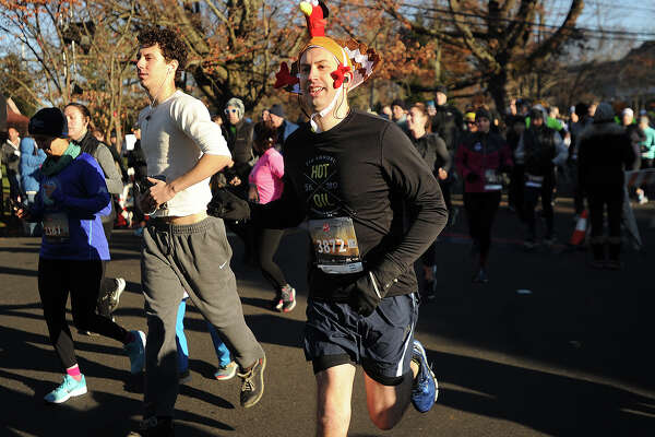 Chris Mackeprang, of Fairfield, is one of many runners to don festive holiday headgear for the annual Pequot Runners 5-mile Thanksgiving Day Road Race in the Southport section of Fairfield, Conn. on Thursday, November 23, 2017. Over 4000 runners registered for this year's race.