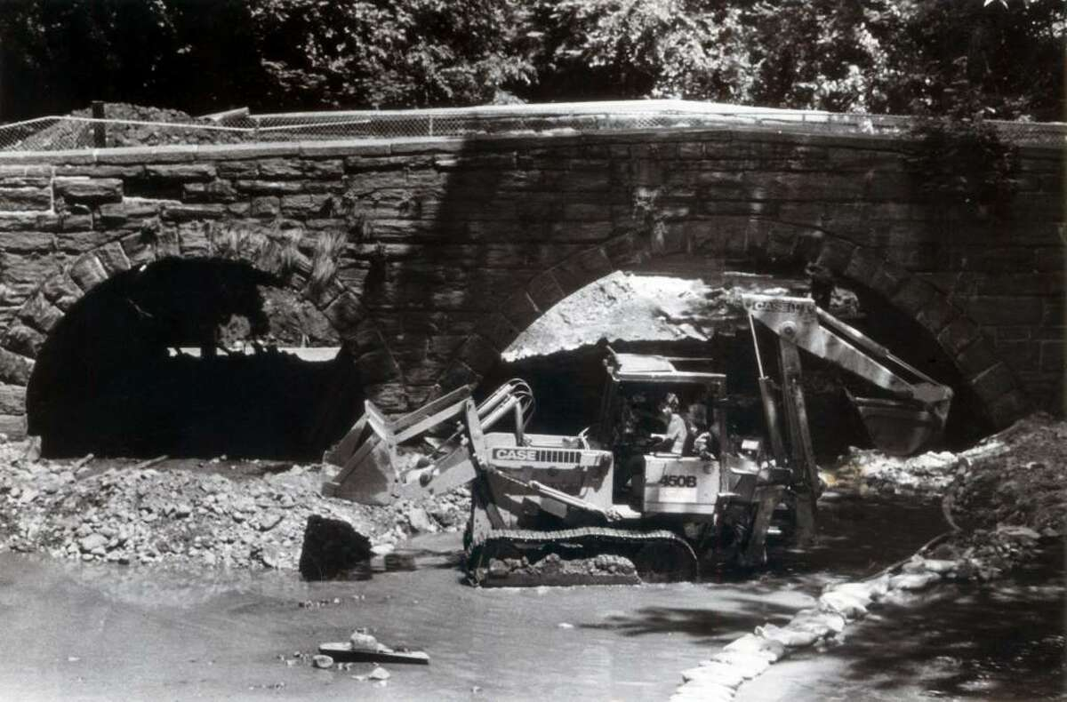 July 1, 1985: Work continued on the North Street Bridge, an 105-year-old landmark in Stamford. With the water low, contractors were able to get equipment below the triple-arch bridge that spans the Rippowam River. Staff file photo.