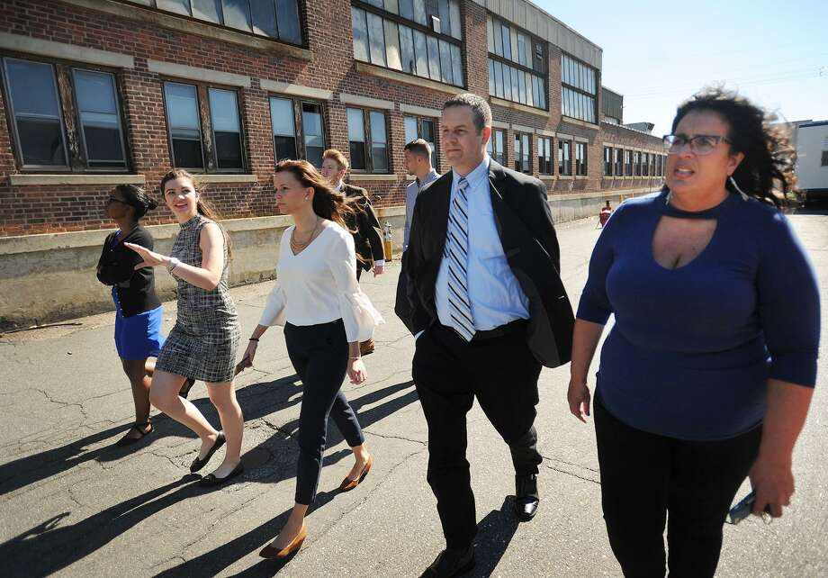 From left, Sacred Heart University students Nicolette Black, 22, of Norwalk; Samantha Jackson, 21, of Trumbull; Assistant Director of the Student Experience in the College of Business Elizabeth Stouch; Brendan Walsh, 22, of Wilton; Julian Linke, 24, of Germany, Associate Professor Joshua Shuart, and Ansonia Economic Development Director Sheila O'Malley tour the Ansonia Copper and Brass property in September. Photo: Brian A. Pounds / Hearst Connecticut Media File / Connecticut Post