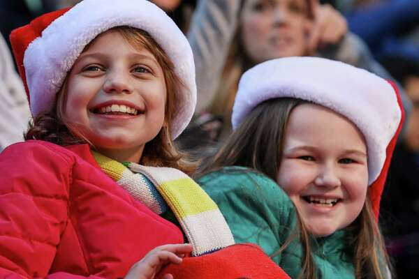 Abigail Smith, 10, left, and her cousin Emily Clay, 7, right, smile as they see Santa during the HEB Thanksgiving Day Parade, Thursday, Nov. 23, 2017, in Houston. Clay came to Houston with her family from Arkansas for the parade and Thanksgiving festivities.