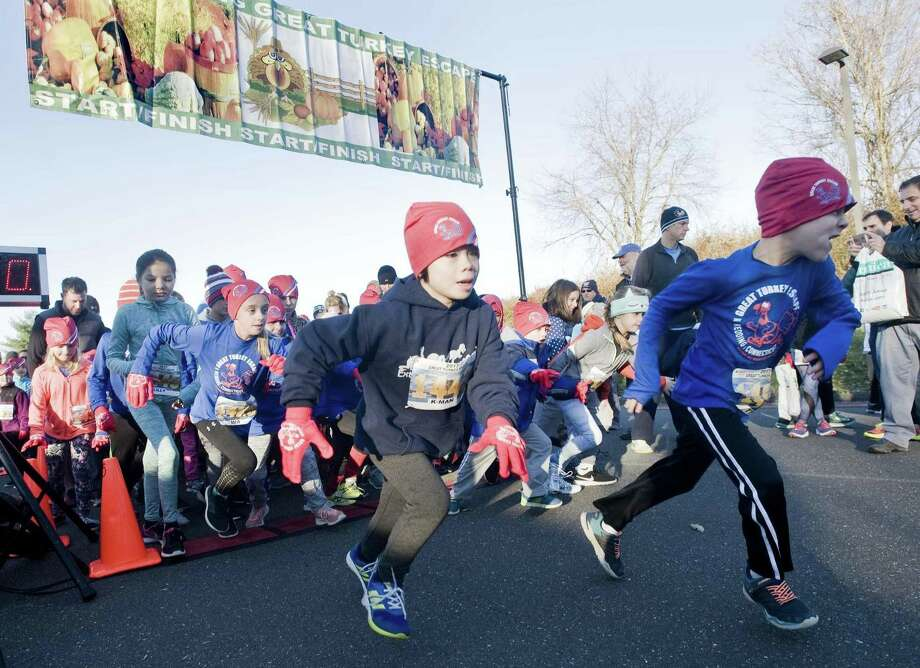 The kids race started out on Thanksgiving at the Redding Community Center. Photo: Scott Mullin / For Hearst Connecticut Media / The News-Times Freelance
