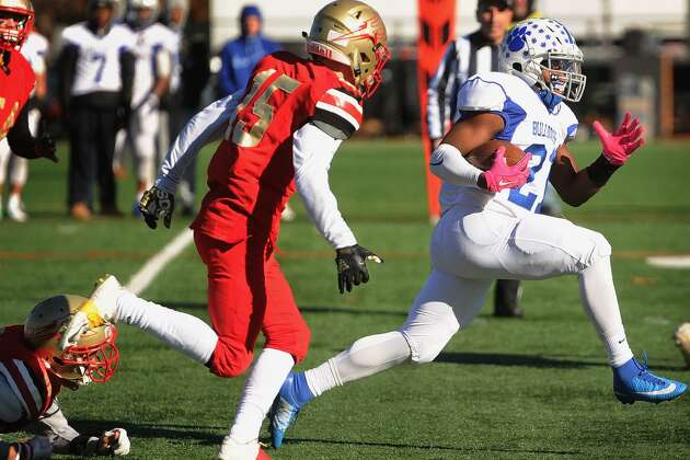 Bunnell running back Ja'len Madison breaks a tackle and is pursued by Stratford defender Jason Sargent in the first half of their Thanksgiving Day football game at Pender's Field in Stratford, Conn. on Thursday, November 23, 2017.
