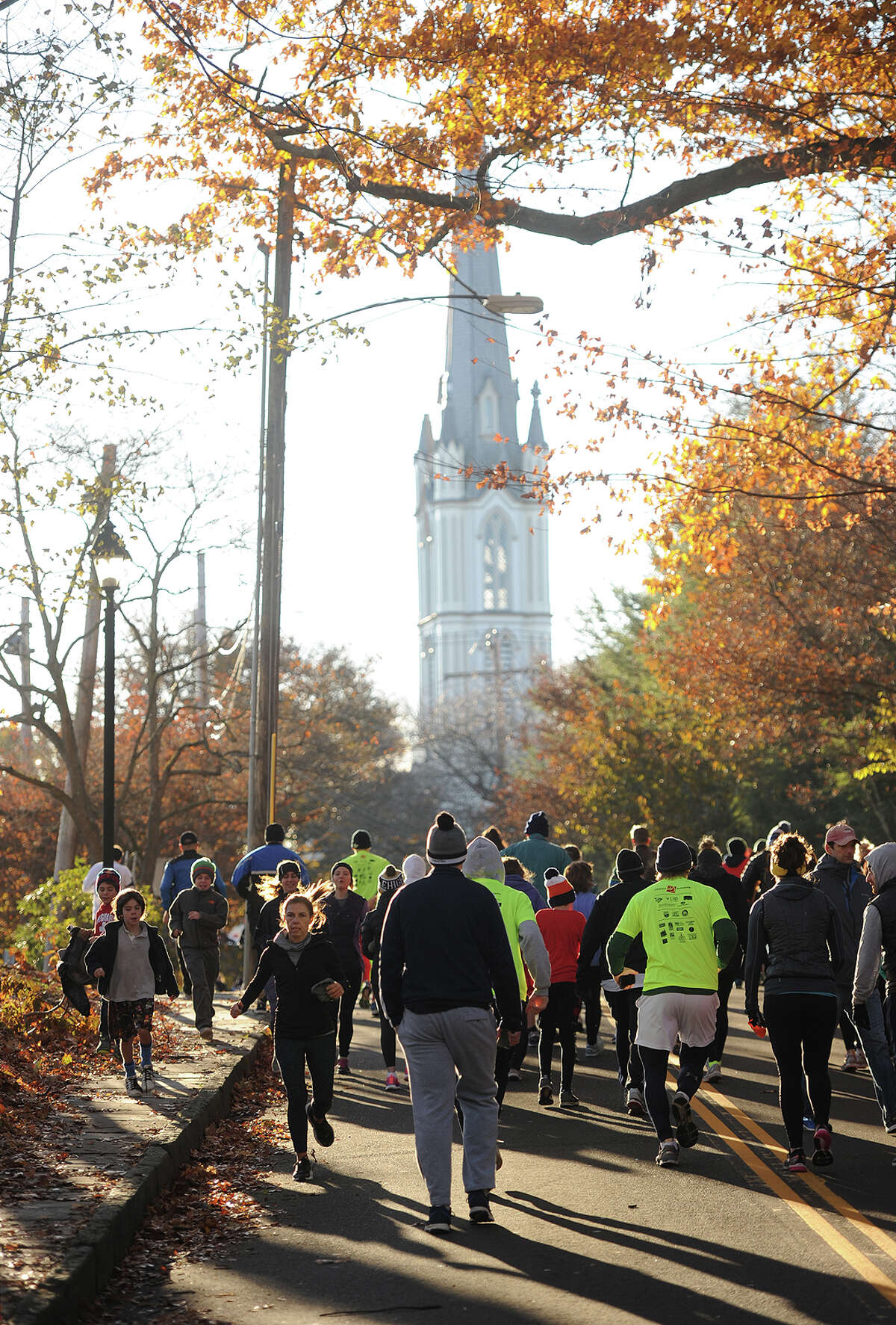 Runners head for the start of the annual Pequot Runners 5-mile Thanksgiving Day Road Race in Fairfield, Conn. on Thursday, November 23, 2017. Over 4000 runners registered for this year's race.