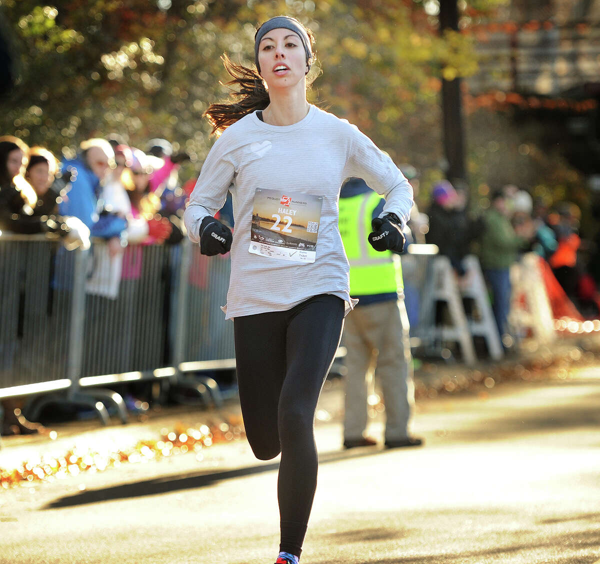 Haley Abing, of Boston, crosses the finish line as the women's winner of the annual Pequot Runners 5-mile Thanksgiving Day Road Race in Fairfield, Conn. on Thursday, November 23, 2017. Over 4000 runners registered for this year's race.