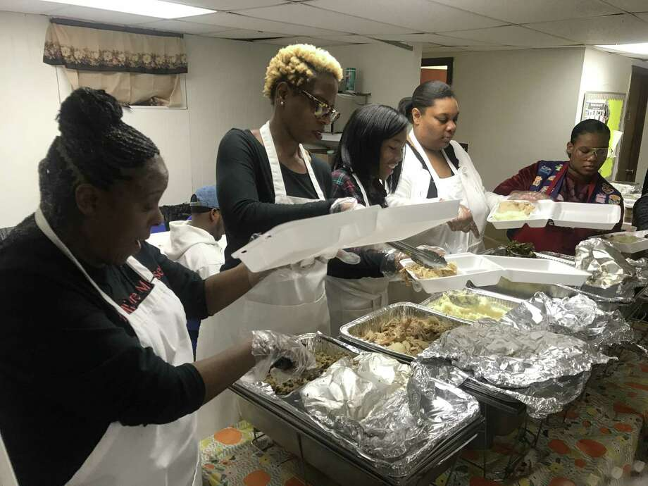 Volunteers prepare Thanksgiving meals at Church of God and Saints of Christ in New Haven on Thursday. Photo: Esteban L. Hernandez / Hearst Connecticut Media