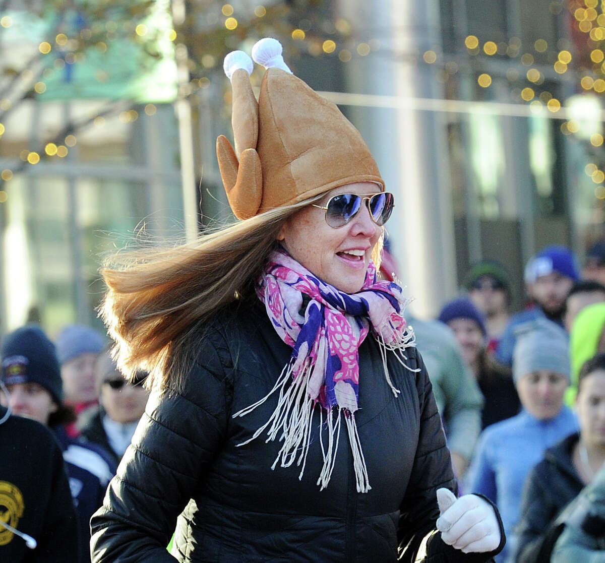 Margaret Vorder Bruegge of Stamford wore a turkey hat while participating in the seventh annual Harbor Point Turkey Trot 5K at Harbor Point in Stamford, Conn., Thursday, Nov. 23, 2017. Yancey Lawrence of Stamford finished first in the race beating Sean McCarthy who finished second.