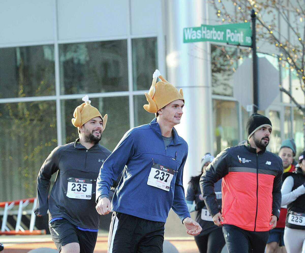 At center, Alec Jahncke of Greenwich wore a turkey hat while participating in the seventh annual Harbor Point Turkey Trot 5K at Harbor Point in Stamford, Conn., Thursday, Nov. 23, 2017. Yancey Lawrence of Stamford finished first in the race beating Sean McCarthy who finished second.