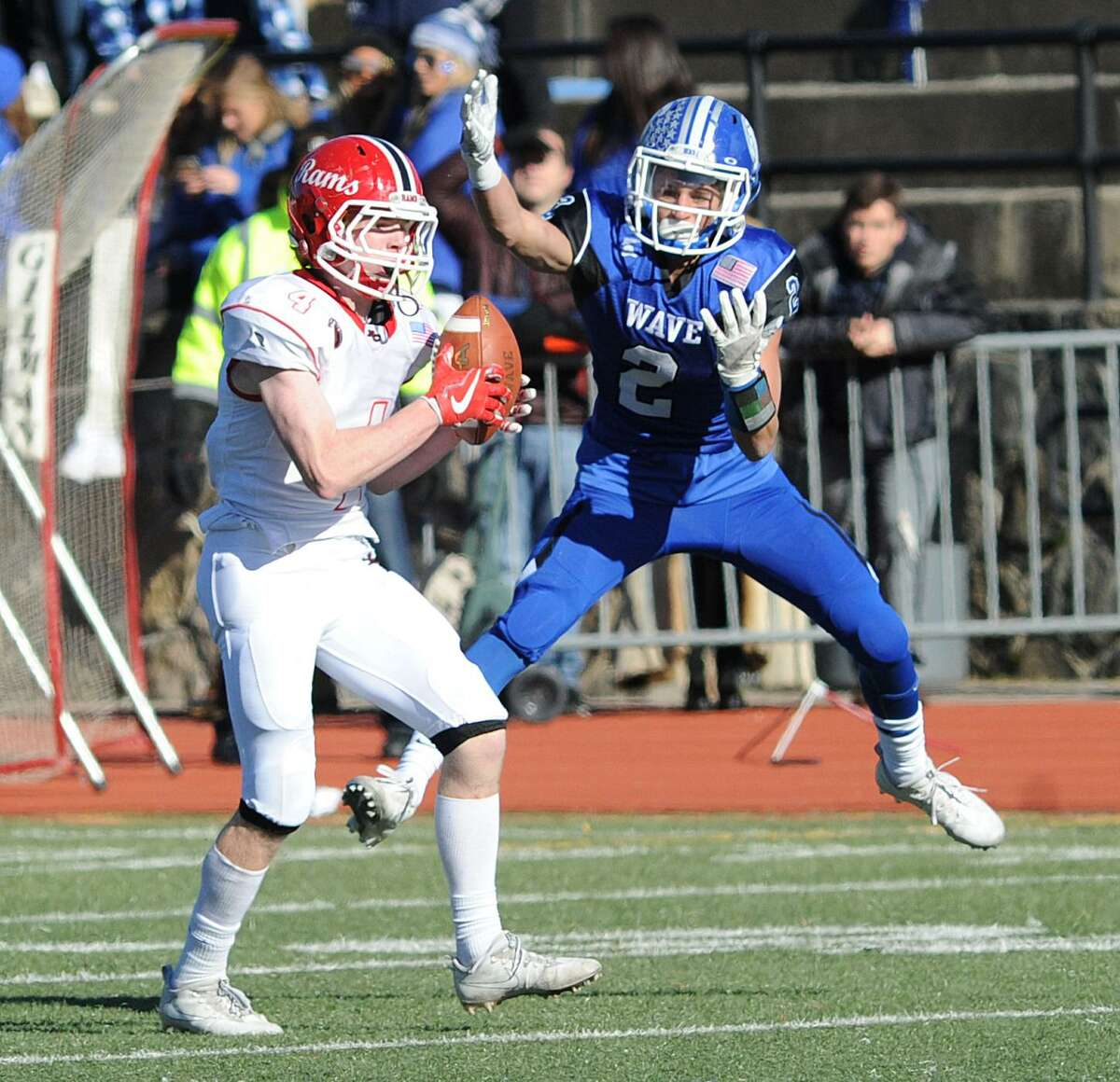New Canaan defender Zachary Miller (#4), left, steps in front of Darien receiver Alexander Dehmel (#2), to intercept a pass that he returned for a touchdown that was the final touchdown of the game in the 4th quarter of the 2017 Turkey Bowl high school football game between Darien High School and New Canaan High School at Boyle Stadium in Stamford, Conn., Thursday, Nov. 23, 2017. New Canaan won the game 27-0, beating an undefeated Darien team that was without starting quarterback Jack Joyce and star defensive back Brian Minicus, both of whom were arrested Wednesday night on charges stemming from an assault earlier in the month.