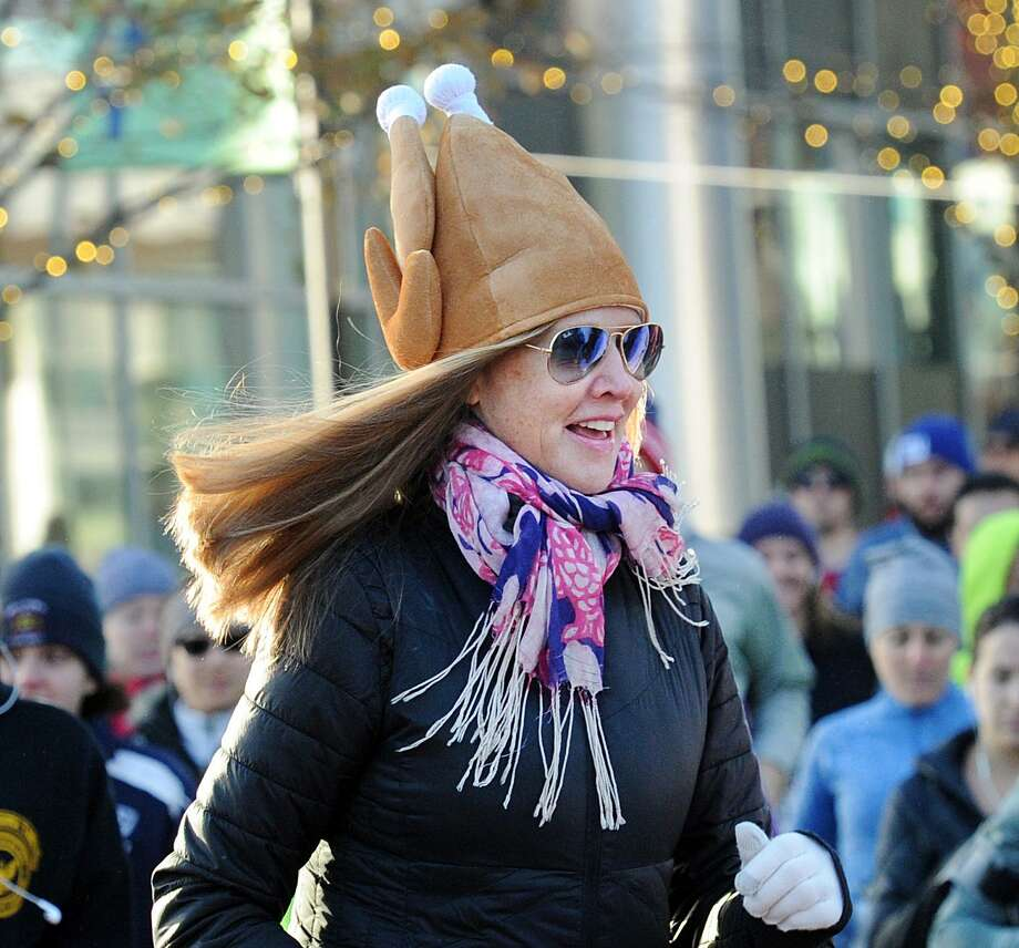 Margaret Vorder Bruegge of Stamford wore a turkey hat while participating in the seventh annual Harbor Point Turkey Trot 5K at Harbor Point in Stamford, Conn., Thursday, Nov. 23, 2017. Yancey Lawrence of Stamford finished first in the race beating Sean McCarthy who finished second. Photo: Bob Luckey Jr. / Hearst Connecticut Media / Greenwich Time
