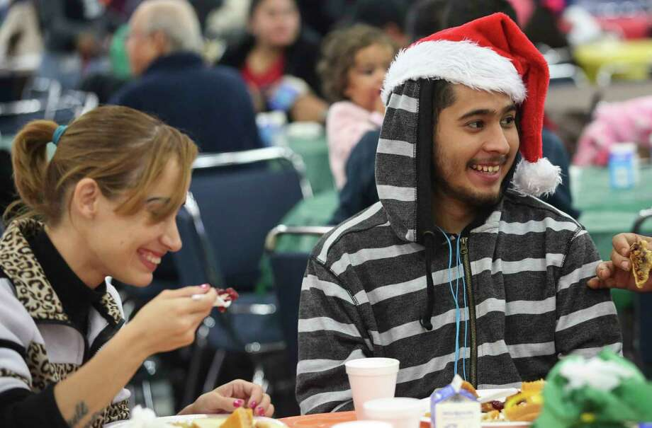 Christina Fanté and Ramon Earl Dominquez share a light moment while having Thanksgiving meal at the annual Super Feast at George R. Brown Convention Center on Thursday, Nov. 23, 2017, in Houston. ( Yi-Chin Lee / Houston Chronicle ) Photo: Yi-Chin Lee, Houston Chronicle / © 2017  Houston Chronicle