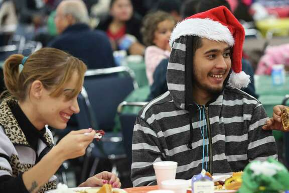 Christina Fanté and Ramon Earl Dominquez share a light moment while having Thanksgiving meal at the annual Super Feast at George R. Brown Convention Center on Thursday, Nov. 23, 2017, in Houston. ( Yi-Chin Lee / Houston Chronicle )
