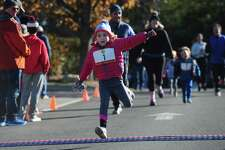 Six-year-old Emma Kayhan from Darien joins nearly 1000 runners as they participate in the 7th annual Rowayton Turkey Trot Thursday, November 23, 2017, at Rowayton Library in Norwalk, Conn. All proceeds from the event benefit the Rowayton Library.