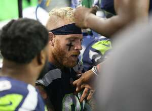 Seahawks defensive lineman Cassius Marsh reacts after having a near scuffle with linebacker Bobby Wagner after a disagreement in the second half of a preseason game at CenturyLink Field on Friday, Aug. 18, 2017. (GRANT HINDSLEY, seattlepi.com)