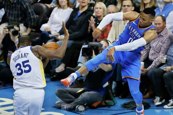 The Thunder's  Russell Westbrook, right, got the best of former teammate Kevin Durant on this play in the second quarter of Wednesday's 108-91 victory over the Warriors.