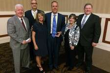 Robert and Stacey Kollman (center) were honored with the Spirit of Philanthropy Award by Wayland Baptist University during a luncheon held Thursday at the Overton Hotel by the Lubbock Chapter of the Association of Fundraising Professionals. Pictured with the honorees are (from left) Mike Melcher, senior major gifts officer; Dr. Kevin Ludlum, Vice President for Advancement; Laurie Hall, first lady; and Dr. Bobby Hall, Wayland president.