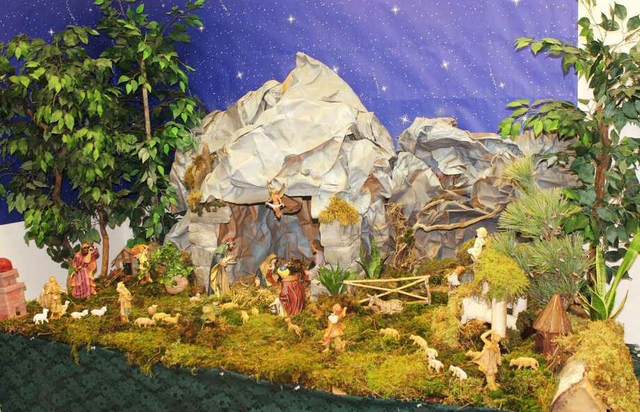 Huge, detailed nativity scenes, like this one,are inspired by a tradition from Florence that is centuries old. Families add new figures and animals to the scenes each year and emblematic pop cultural figures like a weePres. Donald Trump or Beyoncesometimes appear. A family may add figures thatrepresent neighbors and coworkers all mingling in a scene where wise men and shepherds visiting Mary, Joseph and Baby Jesus. Photo: Lynda J. Edwards, Gene Loparco