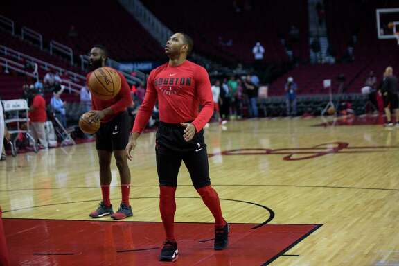 Rockets guard Eric Gordon, right, and James Harden display their warm-up attire before a game against the Raptors at Toyota Center. Players customize their warm-up outfits when they can.
