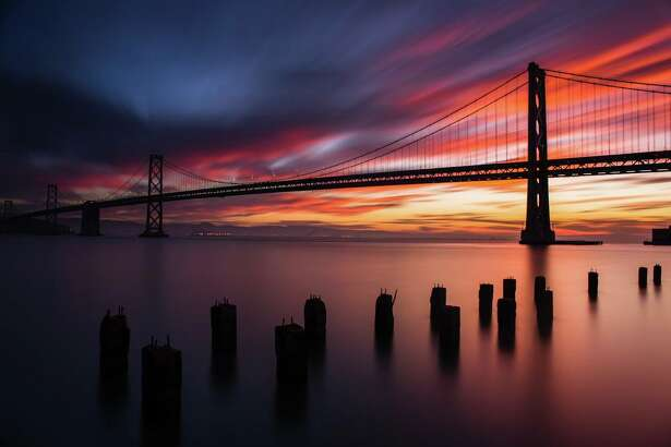 A spectacular sunset colored the Bay Area sky crimson and orange on Thanksgiving evening, Nov. 23, 2017. SFGATE readers shared their best photos.