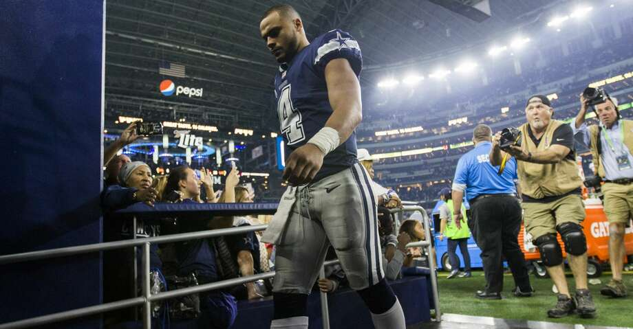 Dallas Cowboys quarterback Dak Prescott (4) walks off the field after a 28-6 loss against the Los Angeles Chargers on Thursday, Nov. 23, 2017 at AT&T Stadium in Arlington, Texas. The Chargers won the game, 28-6. (Ashley Landis/Dallas Morning News/TNS) Photo: Ashley Landis/TNS