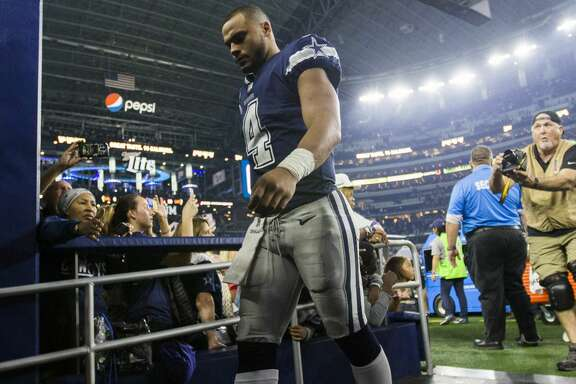 Dallas Cowboys quarterback Dak Prescott (4) walks off the field after a 28-6 loss against the Los Angeles Chargers on Thursday, Nov. 23, 2017 at AT&T Stadium in Arlington, Texas. The Chargers won the game, 28-6. (Ashley Landis/Dallas Morning News/TNS)  NO MAGAZINE SALES MANDATORY CREDIT; NO SALES; INTERNET USE BY TNS CONTRIBUTORS ONLY