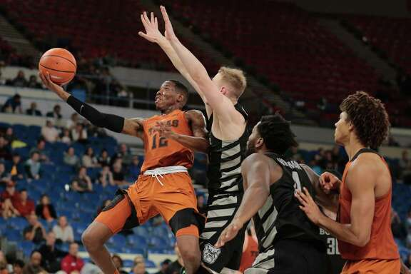 Texas guard Kerwin Roach, left, gets past a Butler defender on his way to the basket in the second half of Thursday's game in Portland, Ore.
