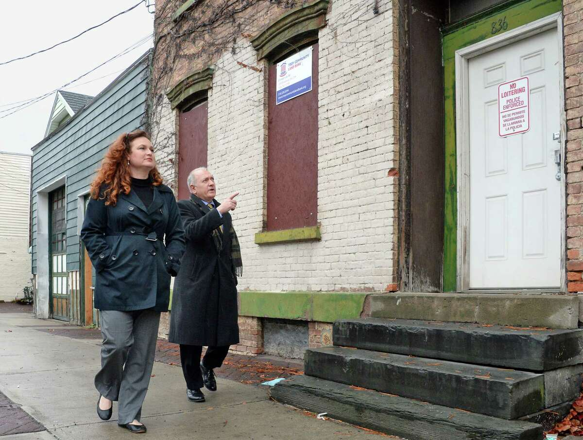 Heather King and Tony Tozzi of the Troy Land Bank at one of their properties at 836 River Street Thursday Nov. 16, 2017 in Troy, NY. (John Carl D'Annibale / Times Union)