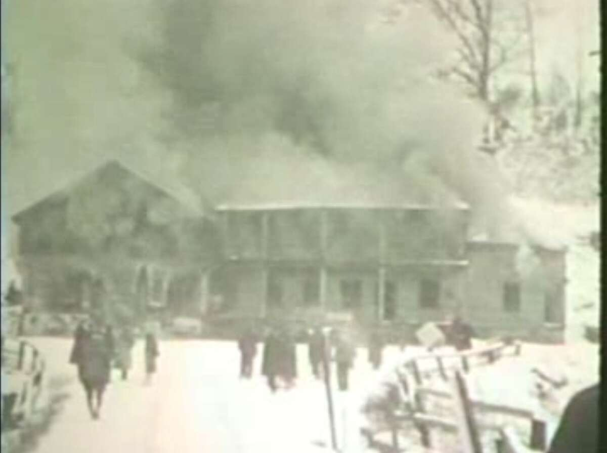 Palmer's Store in Conklingville was burned to make way for the Great Sacandaga Lake reservoir. This photo is a still from 8 mm film shot by the Hudson River Black River Regulating District.