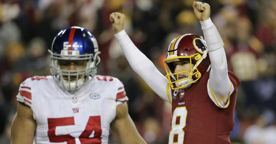Washington Redskins quarterback Kirk Cousins (8) celebrates wide receiver Josh Doctson's touchdown as he walk past New York Giants defensive end Olivier Vernon (54) during the second half of an NFL football game in Landover, Md., Thursday, Nov. 23, 2017. (AP Photo/Mark Tenally) Photo: Mark Tenally/Associated Press