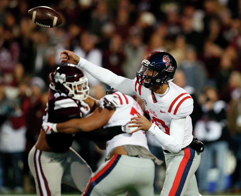Mississippi quarterback Jordan Ta'amu passed for two touchdowns in the Rebels' Egg Bowl upset of No. 14 Mississippi State at Starkville, Miss. Photo: Rogelio V. Solis, STF / Copyright 2017 The Associated Press. All rights reserved.