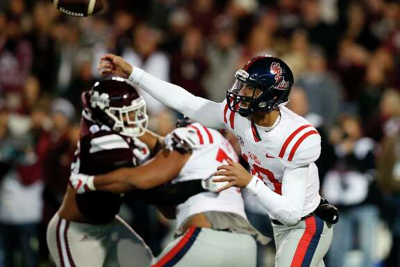 Mississippi quarterback Jordan Ta'amu passed for two touchdowns in the Rebels' Egg Bowl upset of No. 14 Mississippi State at Starkville, Miss.