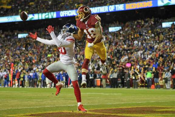 New York Giants cornerback Janoris Jenkins (20) reaches for a pass intended Washington Redskins wide receiver Josh Doctson (18) during the first half of an NFL football game in Landover, Md., Thursday, Nov. 23, 2017. (AP Photo/Nick Wass)
