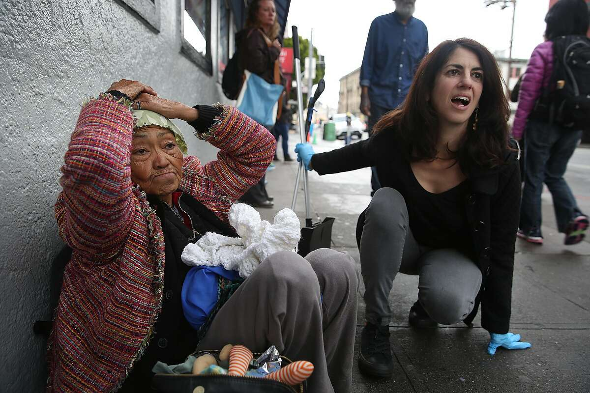 Supervisor Hillary Ronen checks on Alice during her sweep who's been homeless hanging around the 16th St. Bart station for several months on Wednesday, November 15, 2017, in San Francisco, Calif.