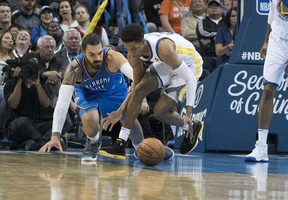OKLAHOMA CITY, OK - NOVEMBER 22: Steven Adams #12 of the Oklahoma City Thunder and Patrick McCaw #0 of the Golden State Warriors battle for the ball during the second half of a NBA  game at the Chesapeake Energy Arena on November 22, 2017 in Oklahoma City, Oklahoma. NOTE TO USER: User expressly acknowledges and agrees that, by downloading and or using this photograph, User is consenting to the terms and conditions of the Getty Images License Agreement. (Photo by J Pat Carter/Getty Images) Photo: J Pat Carter, Getty Images