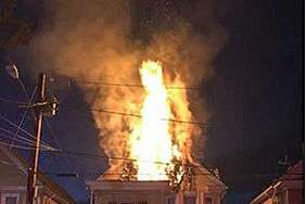Flames shoot out from the third-floor of a house at 132-134 Shepard St. in Hamden on Thursday, Nov. 23, 2017. Fire officials said a firefighter was injured fighting the Thanksgiving Day blaze and the building was declared uninhabitable