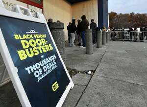 People lined up before dawn to get a chance at discounts during Black Friday shopping at Best Buy in Crossgates Mall in Guilderland.