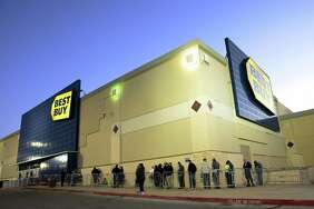People wait in line in the very early morning hours, about 6:30, to get into the Best Buy near the intersection of Loop 410 and San Pedro on Friday, Nov. 24, 2017.