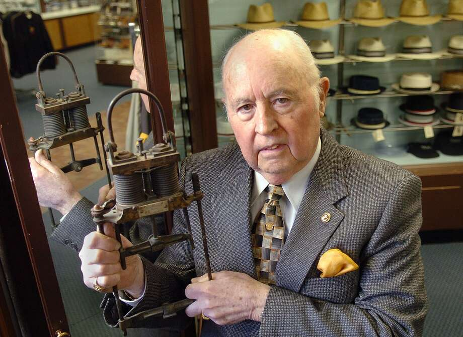 Charles Seccombe, of Seccombe's Men's Store in Ansonia, Conn., holding an arc light created by Willam Wallace in the late 1800's. On Saturday, Nov. 18, 2017, Seccombe died at age 91. Photo: File Photo / Connecticut Post