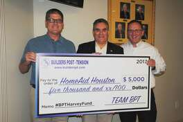 Presenting the donation are Greg Tomlinson (left) and Greg Madrey (righ), of Builders Post Tension, with Salty Thomason, president of HomeAid Houston.