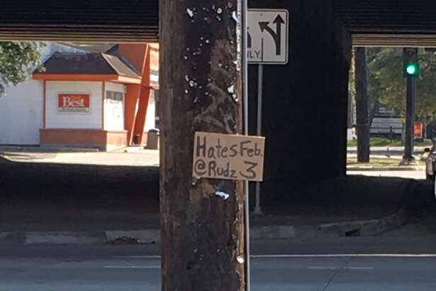 Sign spotted off the Southwest Freeway announcing the first Hates gig in over a year.