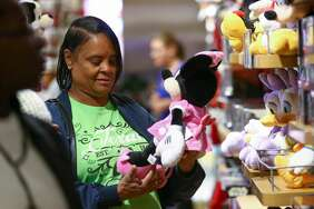 Ceecee Pippins looks for a gift for her first granddaughter inside the Disney store during Black Friday at The Galleria on Nov. 24, 2017.