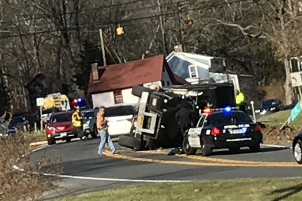 Route 7 is closed near the intersection with Route 37 after a dump truck rolled over.