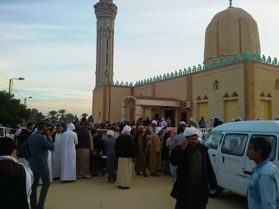 People gather at the site of the Egypt Sinai mosque bombing in Al-Arish, Egypt on November 24, 2017. The death toll from a bomb that went off outside a mosque in the city of Al-Arish in the northern Sinai Peninsula following Friday prayers has climbed to a whopping 235, according to official sources. At least 109 others were injured in the blast, which occurred in the city's Al-Rawda neighborhood. Photo: Anadolu Agency/Getty Images