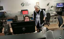 Longtime executive editor Sandy Close (right) and marketing associate Dana Levine (middle) at the New America Media office on Monday, November 20, 2017, in San Francisco, Calif.  Pacific News Service and its offshoot New America Media will close at the end of the month, after nearly a half century in the Bay Area.