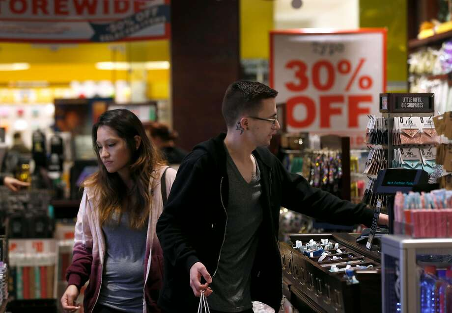 Karina and Brandon Hernandez shop in the Typo gift store during Black Friday sales at Stoneridge Shopping Center in Pleasanton. Photo: Paul Chinn, The Chronicle